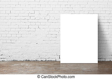 poster standing next to a brick wall
