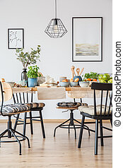 Posters in bright dining room