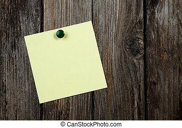 postit - postint hanging on a wood panel