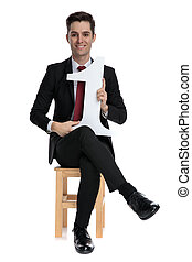 Postive businessman holding a number one