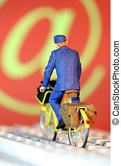 Postman delivering mails - Postman on a bicycle delivering...