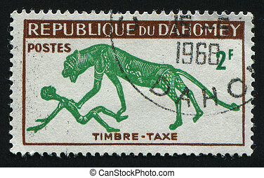 postmark - DAHOMEY - CIRCA 1966: The leopard has attacked...