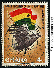 postmark - GHANA - CIRCA 1966: Eagle and flag, circa 1966.