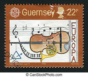 postmark - GUERNSEY- CIRCA 1985: Music, cello, French horn,...