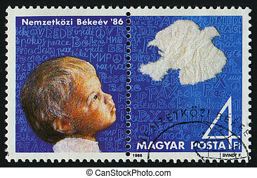 postmark - HUNGARY - CIRCA 1986: Peace Year. The boy with a...