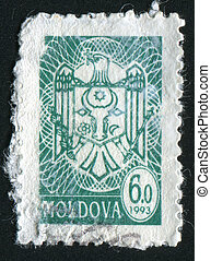 postmark - MOLDOVA - CIRCA 1993: eagle. The national arms,...