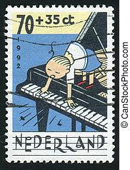 postmark - NETHERLANDS - CIRCA 1992: Children Making Music,...