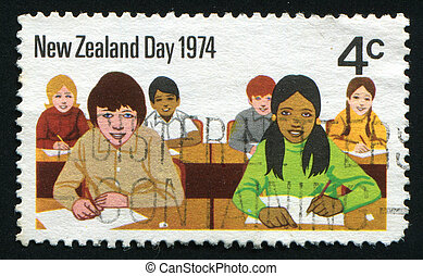 postmark - NEW ZEALAND - CIRCA 1974: Children go to school,...