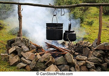 Pot and kettle over the campfire