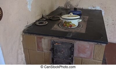 pot boil old rural stove and water flow out burn. 4K - pot...