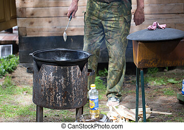 Pot for cooking on the street