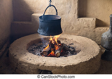 pot hanging over the fire