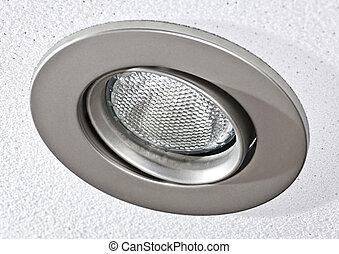 Pot light in ceiling tile - Closeup of pot light recessed...