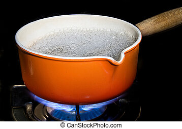 Pot of boiling water - A pot of boiling water on a modern...