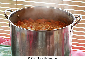 Pot of curry - A pot of spicy curry simmering in a metal pot