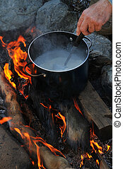 Pot of soup on camping fire