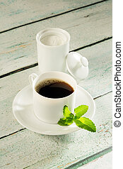 Pot of stevia sweetener and coffee - Coffee cup and a pot of...