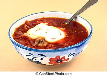 pot of ukrainian borsch and cream with spoon