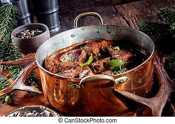 Pot of Venison Goulash Seasoned with Fresh Herbs - Copper...
