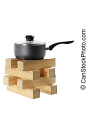 Pot on Stack of Wood