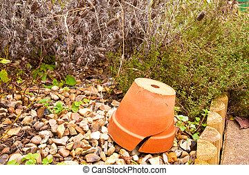 Pot - Upturned terracotta pot in a garden