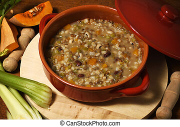 Pot with soup of legumes