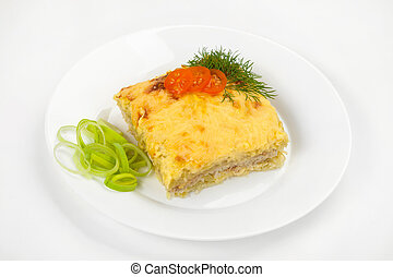 potato baked pudding with meat on a white plate