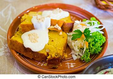 Potato cake with sour cream