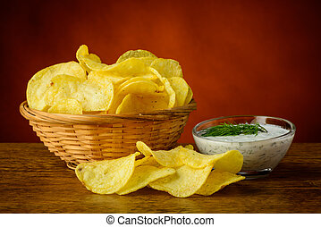Potato chips and dill dip - still life with potato chips and...