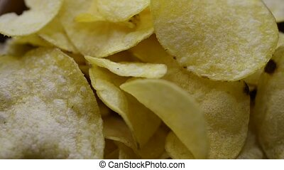 potato chips background - crispy potato chips rotating,...