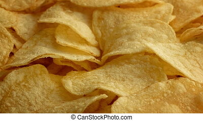 Potato Chips Closeup - Closeup of potato chips turning...