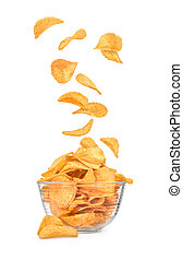 Potato chips falling in a bowl isolated on white