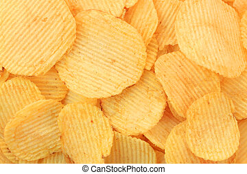 Golden potato chips background (rippled)