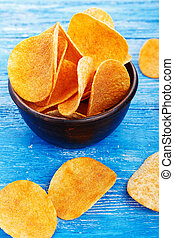 potato chips in a clay plate