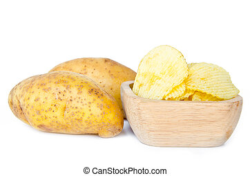 Potato chips in a wooden bowl and fresh potatoes