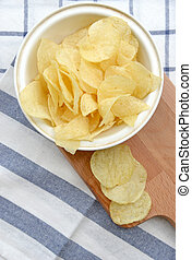 potato chips in wooden plate