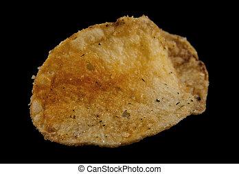 potato chips on a black background