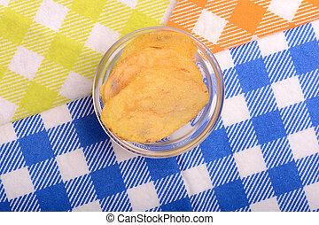 Potato chips on glass bowl, close up