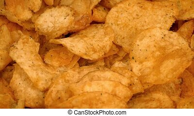 Potato Chips Rotating Closeup - Tasty potato chips rotate on...