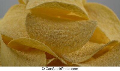 potato chips rotating macro, seamless loopable