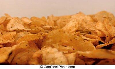 Potato Chips Rotating On Plate - Tasty potato chips rotate...
