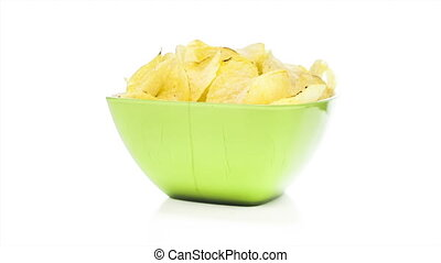 Potato chips rotating on the white table with white seamless...