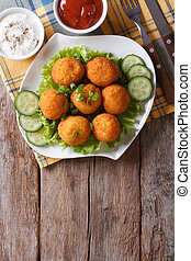 croquette balls with sauce on a plate. vertical top view - ...