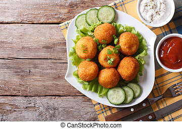 potato croquette with sauce on a plate top view horizontal...