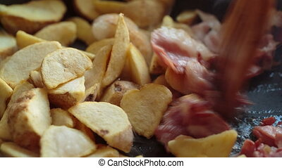 potato fried and bacon - slices of potato fried golden and...