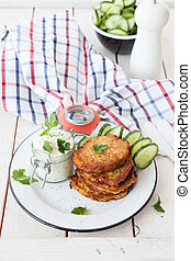 Potato fritters with sour cream