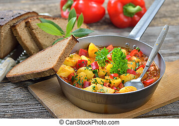 Potato goulash - Hot vegetarian potato goulash served in an...