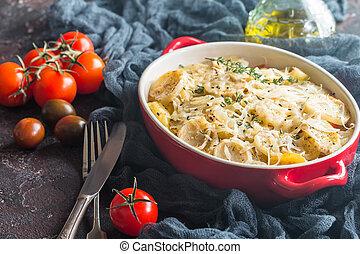 Potato gratin, in rustic dish. Delicious sliced potatoes...
