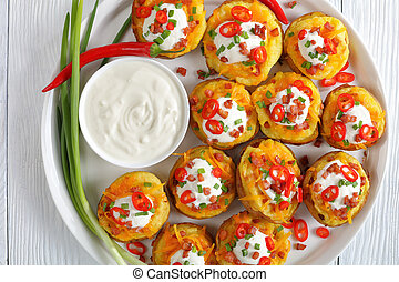 potato halves loaded with cheese, bacon