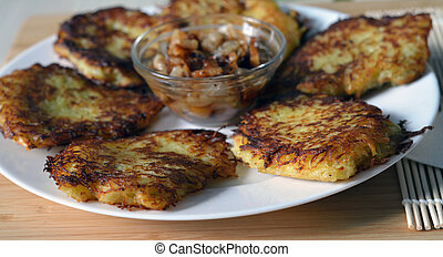 potato pancakes (hashbrown) on the white plate